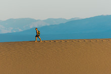 Person Walking On Sand Dune In Death Valley