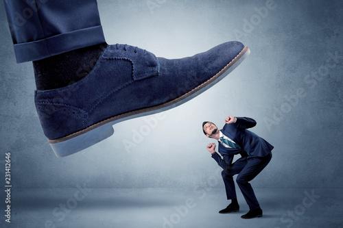Spoed Foto op Canvas Wanddecoratie met eigen foto Big foot trying to crush small man who is afraid of that