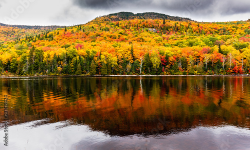 Fotobehang Donkergrijs Fall colors of Lac Legault with Mont Kaaikop in the background, in cottage country in the Laurentians, Quebec, Canada.