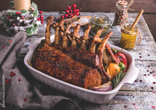 Canvas Print Grilled roasted Rack of lamb with vegetables. New Year's food.