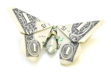Dollar Folded Origami Style Into A Butterfly. Isolated On White Background