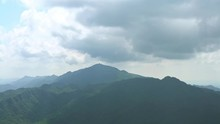 4K, Elevated View Of Mountains WuFenShan In Cloudy Day. Beautiful Mount Wu Fen Shan, Grassy Peak Located On A Ridge Between Keelung And Pingxi In New Taipei City. Landscape Of Hiking Trail Summer-Dan