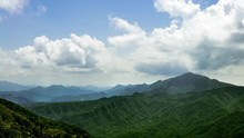 4K, Timelapse Of Elevated View Mountains WuFenShan In Cloudy Day. Beautiful Mount Wu Fen Shan, Grassy Peak Located On Ridge Between Keelung And Pingxi In New Taipei City. Landscape Of Hiking Trail-Dan