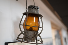 Old Vintage Oil Lamp Hanging On The Side Of The White Wall.