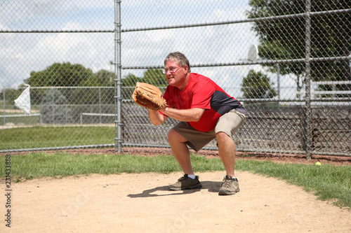 Father coach being catcher at a baseball practice