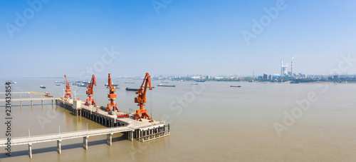 Spoed Foto op Canvas Poort inland river modern cargo wharf panorama