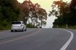 Blurred car trip travel asphalt road on mountain at Hills Banchang Rayong Thailand.