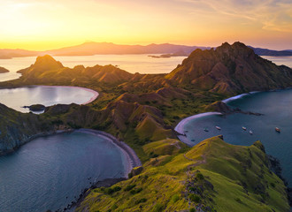 Aerial view of majestic Padar Island, with dramatic sunlight during sunset.