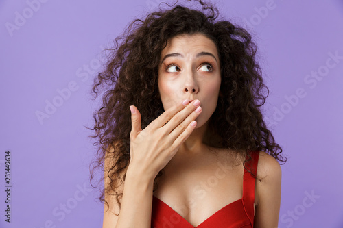 Close up portrait of a scared woman with dark curly hair