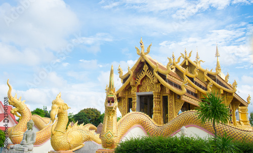 Staande foto Bedehuis Beautiful thai temple with blue sky background.