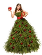 Christmas Tree Dress, Fashion Woman And Present Gifts Isolated Over White Background