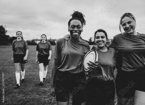 Obraz na plátně Happy rugby players walking together