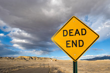 Dead End Sign On A Dead End Road In The Desert