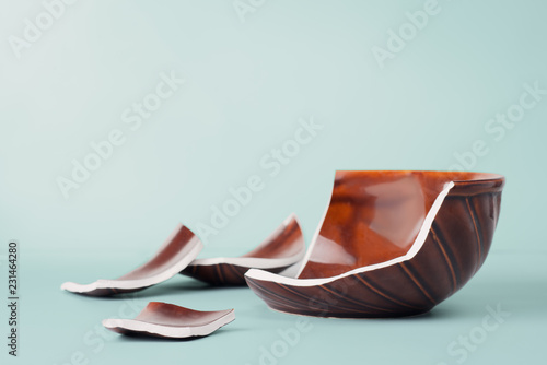Broken bowl on blue background