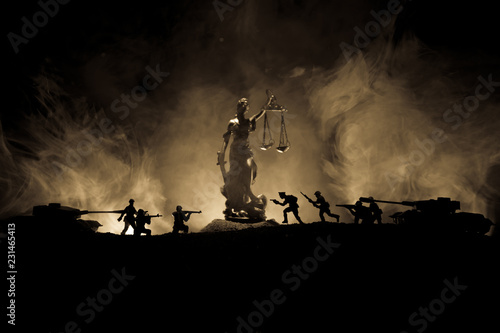 Keuken foto achterwand Nasa War - no justice concept. Military silhouettes fighting scene and The Statue of Justice on a dark toned foggy background.
