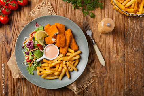 Fish sticks with fries and salad.