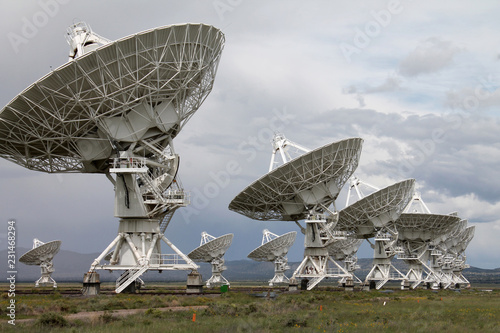 The Very Large Array (VLA) radio-astronomy antennas, in New Mexico, is one of the most impressive observatories in the world. The Sun was piercing through after a major storm during a public tour.