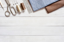 Sewing Items On The Light Wooden Table