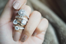 Close Up Of An Elegant Diamond Rings On Woman Finger.love And Wedding Concept.soft And Selective Focus.