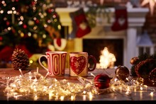 Christmas Still Life With Mugs And Fireplace