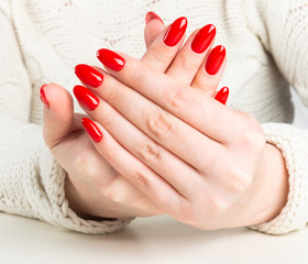 Fototapeta young woman with red manicure on nails