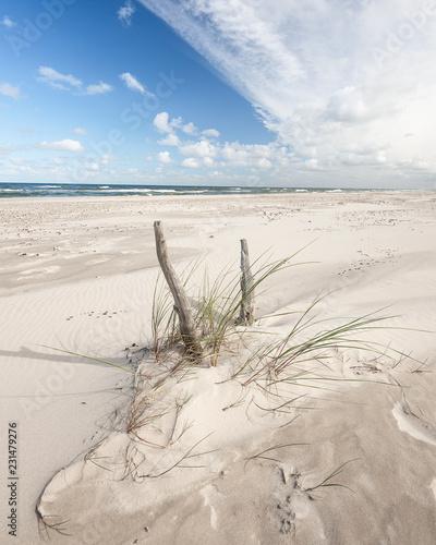 endless-empty-sandy-beach-on-baltic-sea-near-leba-sand-dunes-in-poland