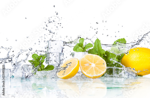 ice cubes and splashing water with mint and lemon on a white background...