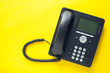 canvas print picture - Deskphone, office and business concept. New ip phone with buttons and big display for communication without interference. Top view. Space for a text. Close up.