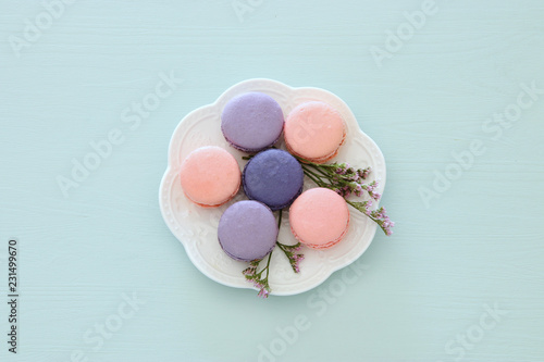 Top view of colorful macaron or macaroon over pastel blue background. Flat lay.