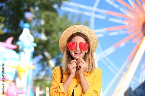Beautiful woman with candies having fun at amusement park Tapéta, Fotótapéta