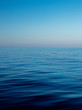Deep Blue colors of the sea and the sky with a bit of a haze