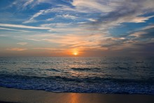 Sunset On The Beach With Warm Breezes And Waves On The Gulf Coast
