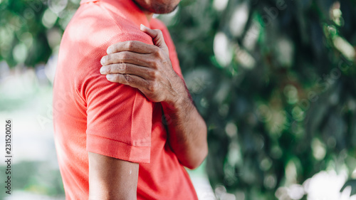 Fotografia young man with shoulder pain , office syndrome , health care concept