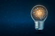 canvas print picture - brain light bulb human brain glowing inside of light bulb on dark blue background