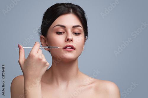 Fotografie, Obraz  Sensual flawless model doing cosmetic injection