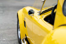 Close Up Of Side Of Yellow Vintage Car