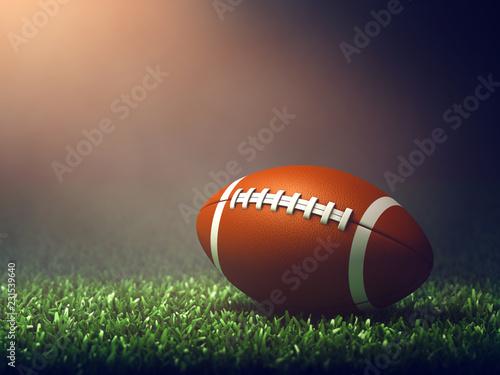Futbol amerykański piłka na polu trawy oświetlone przez reflektor, noc Game