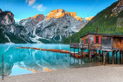 Spectacular wooden boathouse on the alpine lake, Dolomites, Italy, Europe Fototapeta