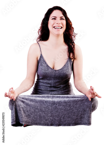 Smiling Caucasian Woman Sitting In Grey Dress On White Background