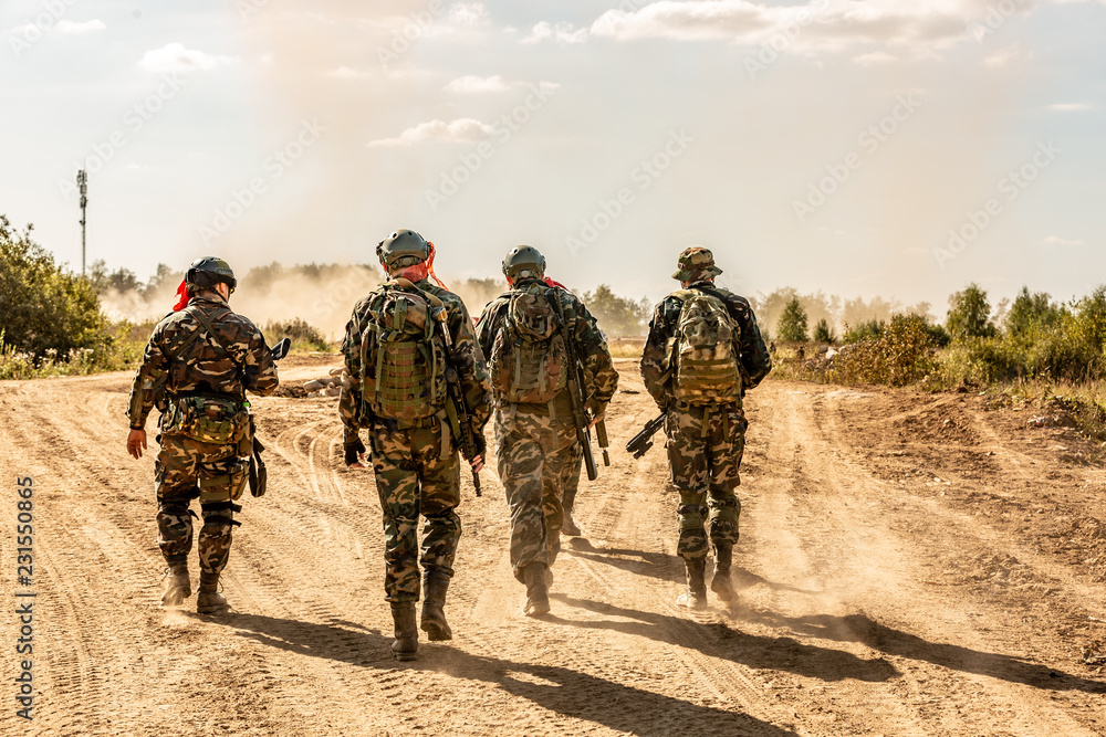 Fototapeta group of soldiers on the Outdoor on army exercises. war, army, technology and people concept