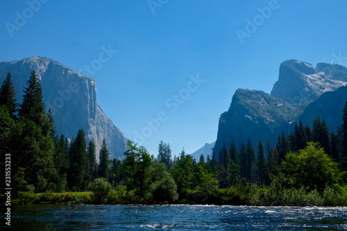 Photo  The view down Yosemite Valley from a river.