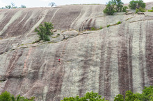 Climbers Ascends A Granite Rock Boulder In The Texas Hill Country