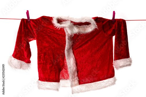 Cuadros en Lienzo le manteau rouge du père noël suspendu à un fil