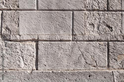 Fotografie, Obraz  grey wall of rectangular stone blocks