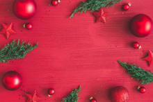 Christmas Composition. Christmas Red Decorations, Fir Tree Branches On Red Wooden Background. Flat Lay, Top View, Copy Space