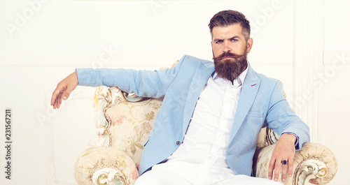 Fashion posing adult man in fashion suit. Perfect to last detail. Close-up of suit. Business men. Sewing. Fashionable suit.