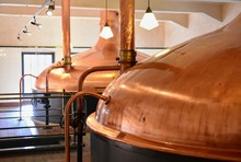 View Of Beer Brewery Interior With Traditional Fermenting Copper Vats.
