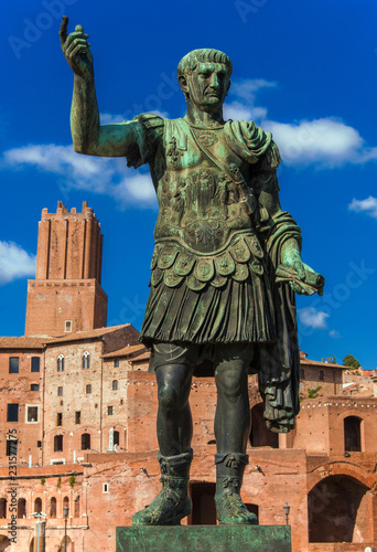 Deurstickers Historisch mon. Caesar Augustus Trajan, emperor of Ancient Rome. Bronze statue with Imperial Fora ruins and Tower of Militia and ruins in the background