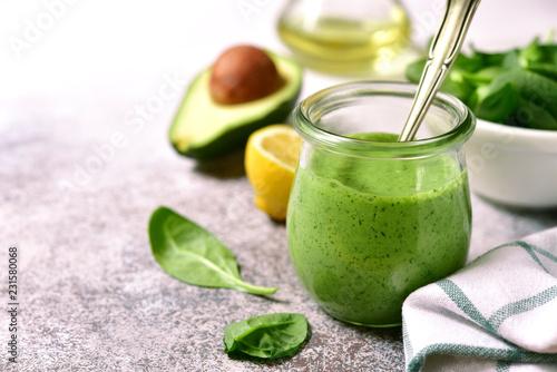 Canvas Print Homemade green avocado spinach sauce.