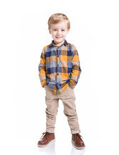 Cute Little Boy Posing With The Hands In His Pockets, Isolated Over White Background